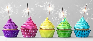 51187451-row-of-colorful-cupcakes-with-sparklers